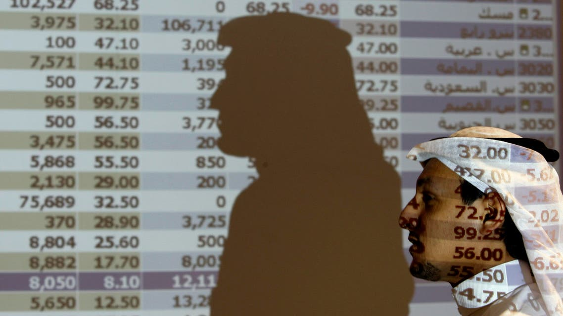 A Saudi trader walks past a stock market monitor in Riyadh, Saudi Arabia, Tuesday. (File: AP)