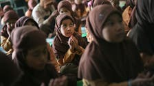 Sexes separated in Indonesian province's schools, next up motorbikes