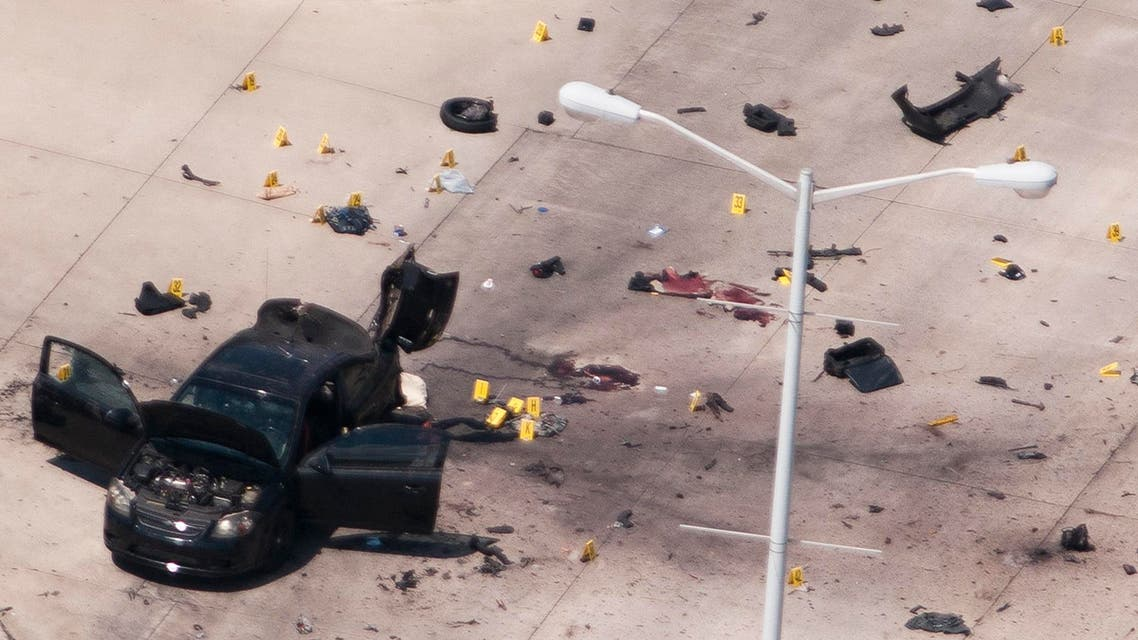 The car that was used the previous night by two gunmen is investigated by local police and the FBI in Garland. (Reuters)