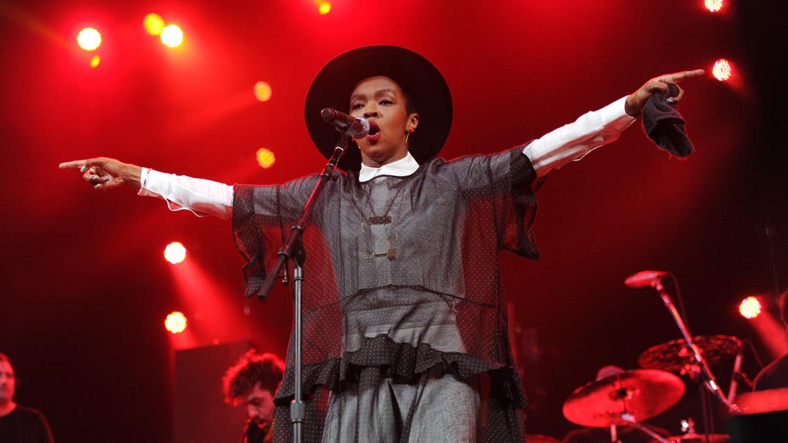 """Singer Lauryn Hill performs at Amnesty International's """"Bringing Human Rights Home"""" Concert at the Barclays Center on Wednesday, Feb. 5, 2014 in New York. (Photo by Evan Agostini/Invision/AP)"""