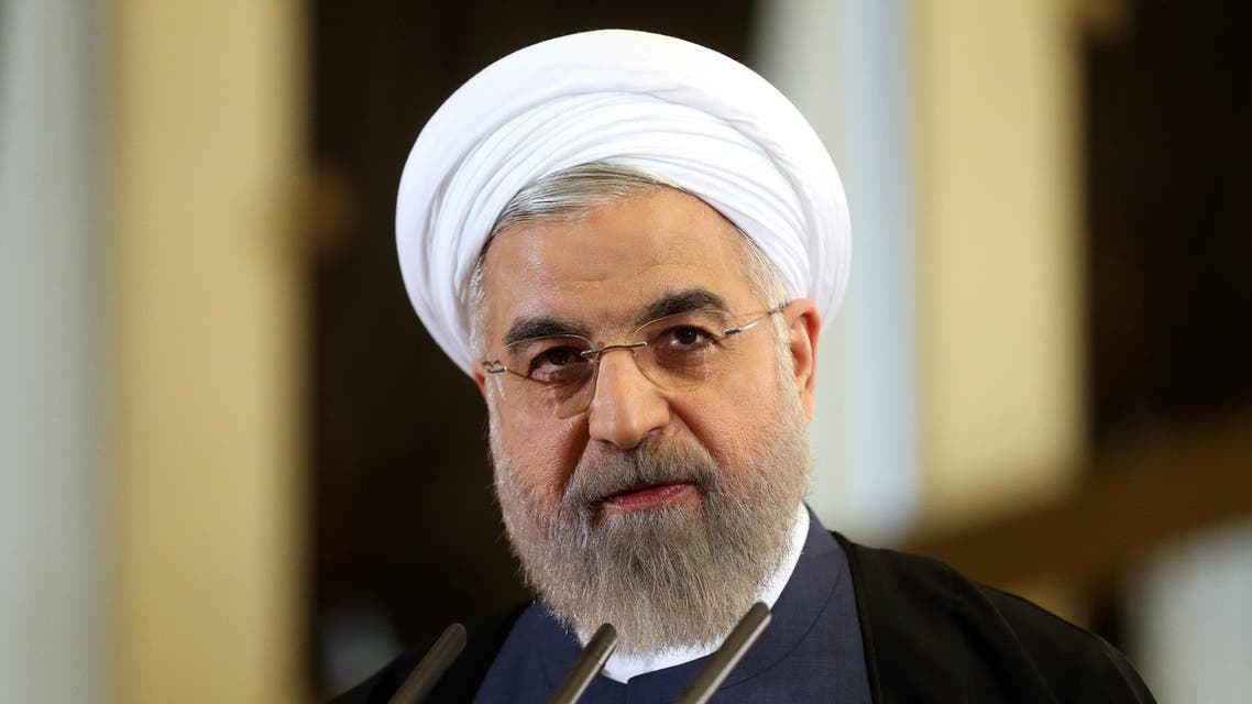 """In this Friday April 3, 2015 file photo, Iranian President Hassan Rouhani speaks in a news briefing at the Saadabad palace in Tehran. As Iran's nuclear negotiators returned home with the framework of a deal with world powers, joyous revelers joked that """"still, there is no whiskey"""" in the Islamic Republic, a jab at its theocratic government. But hard-liners here aren't laughing. Hard-liners face a crisis as Iran looks to reach a permanent deal with world powers over its contested nuclear program, long a point of nationalistic pride. (AP Photo/Ebrahim Noroozi, File)"""