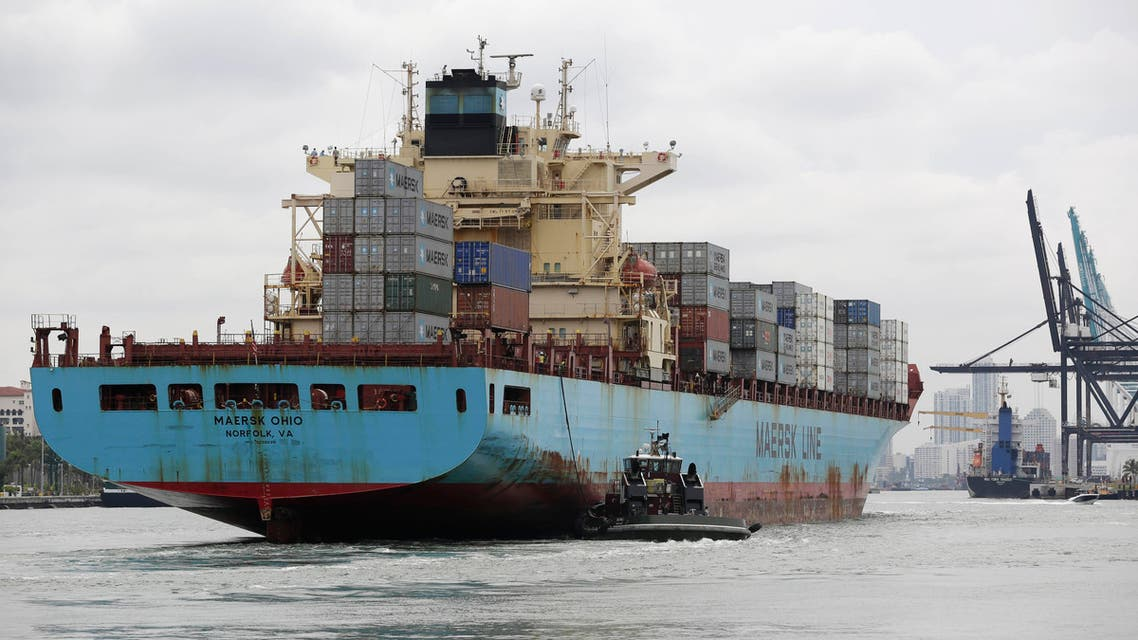 In this Friday, May 16, 2014 file photo, a Maersk Line vessel is guided by a tugboat as it heads into the Port of Miami off of Miami Beach, Fla. (AP)