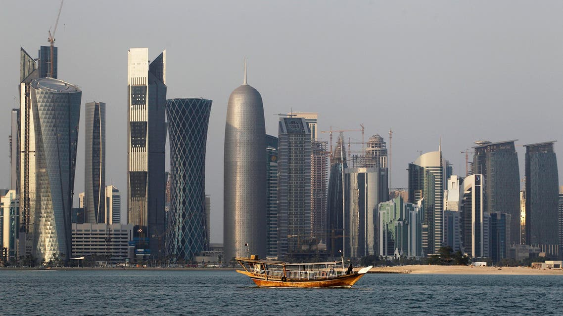 In this Thursday Jan. 6, 2011 file photo, a traditional dhow floats in the Corniche Bay area with tall buildings of the financial district in the background. The 2022 World Cup in Qatar, the wealthy oil- and gas-producing Gulf nation with giant look-at-me ambitions that belie its small size, is shaping up as a unique experience. (AP Photo/Saurabh Das, File)