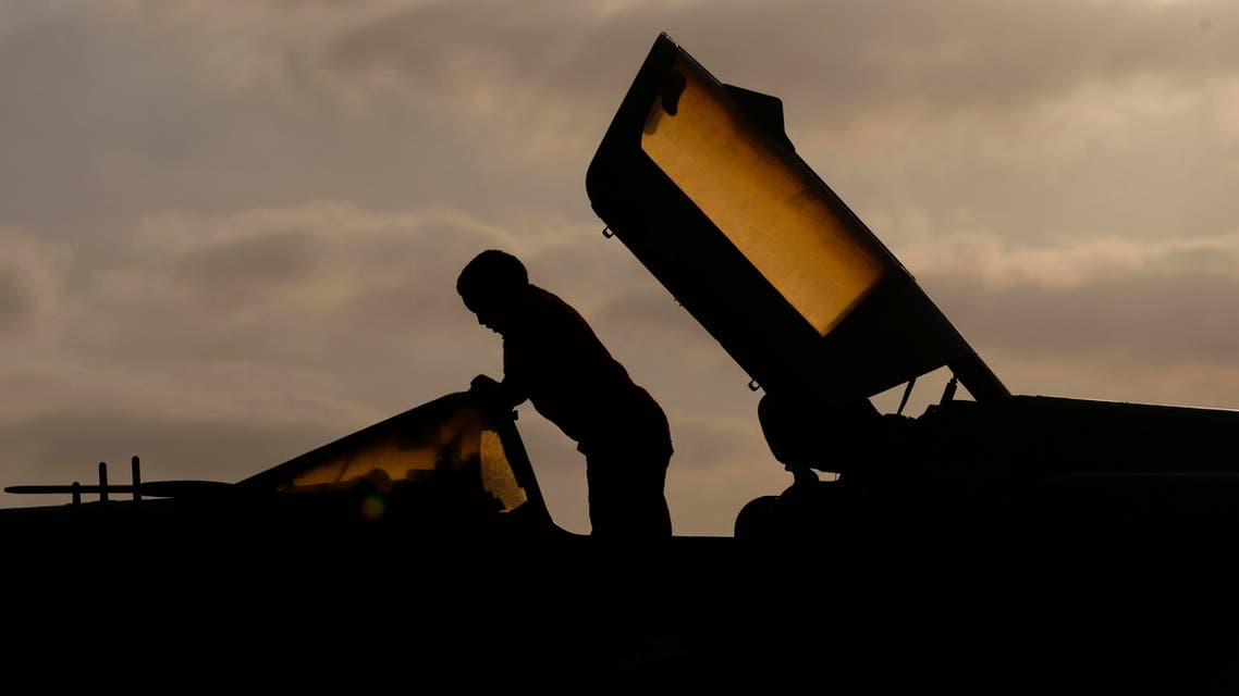 A Libyan boy sitting on a destroyed army MIG-21 jet fighter in the rebel-held Benghazi, Libya, Saturday, July 2, 2011. (AP Photo/Hassan Ammar)