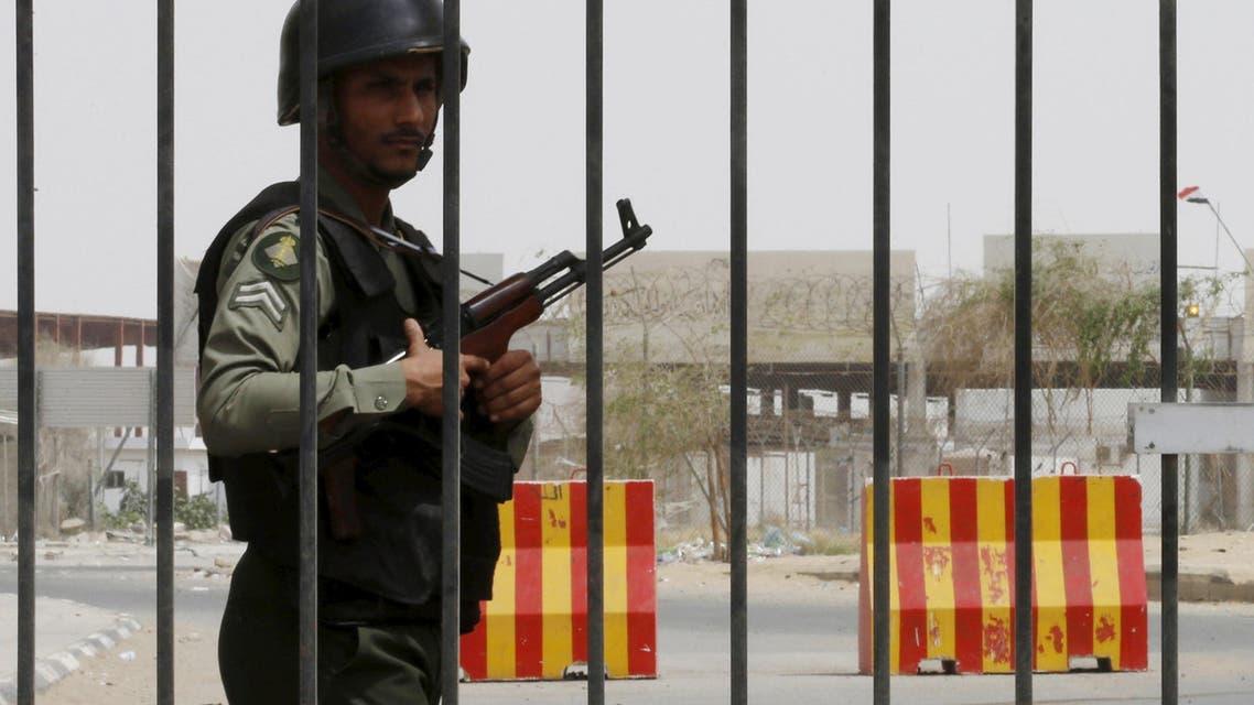 A member of Saudi security forces stands guard at Al-Tiwal crossing in Jizan on Saudi Arabia's border with Yemen, April 7, 2015. REUTERS