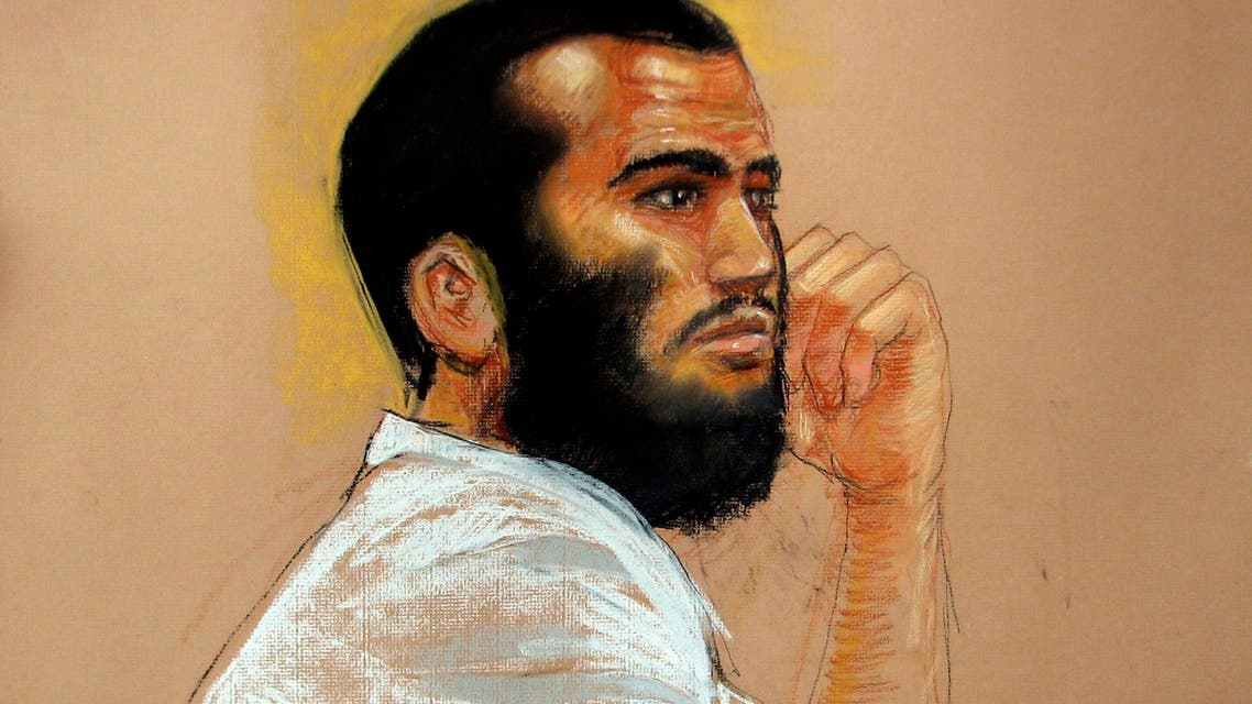 In an April 28, 2010 file artists rendering, Canadian defendant Omar Khadr attends his hearing in the courthouse for the U.S. military war crimes commission at the Camp Justice compound on Guantanamo Bay U.S. Naval Base in Cuba. In a courtroom in Guantanamo Bay, Khadr withdrew his previous not-guilty plea and then pleaded guilty, Monday Oct. 25, 2010. (AP Photo/The Canadian Press, Janet Hamlin, Pool)