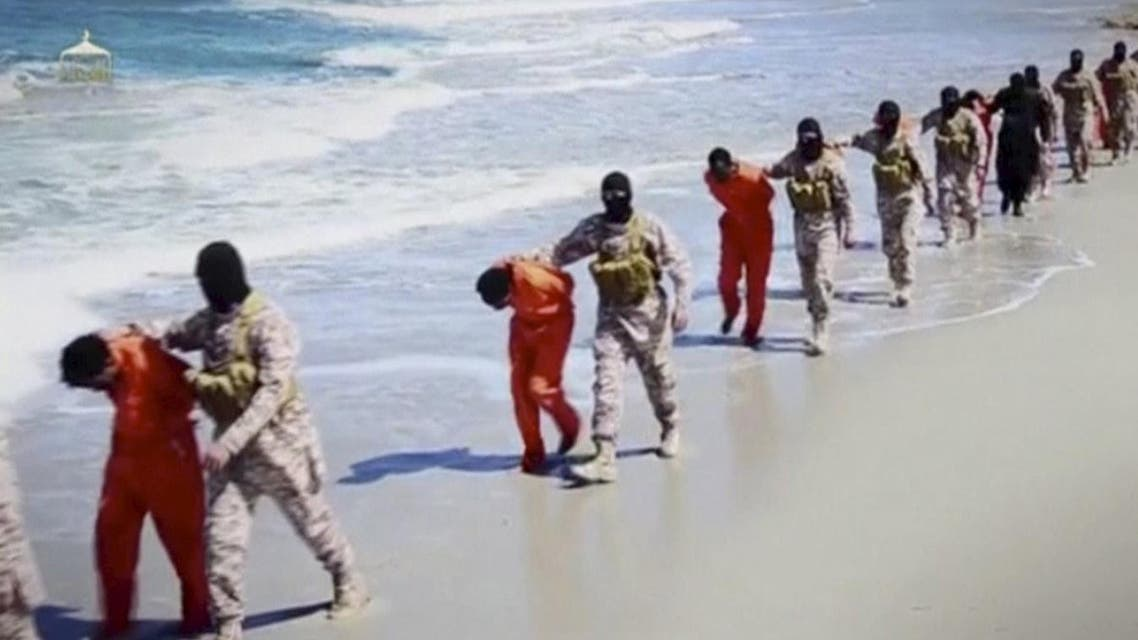 Islamic State militants lead what are said to be Ethiopian Christians along a beach in Wilayat Barqa, in this still image from an undated video made available on a social media website on April 19, 2015. The video purportedly made by Islamic State and posted on social media sites on Sunday appeared to show militants shooting and beheading about 30 Ethiopian Christians in Libya. Reuters was not able to verify the authenticity of the video but the killings resemble past violence carried out by Islamic State, an ultra-hardline group which has expanded its reach from strongholds in Iraq and Syria to conflict-ridden Libya. Libyan officials were not immediately available for comment. Ethiopia said it had not been able to verify whether the people shown in the video were its citizens. REUTERS/Social Media