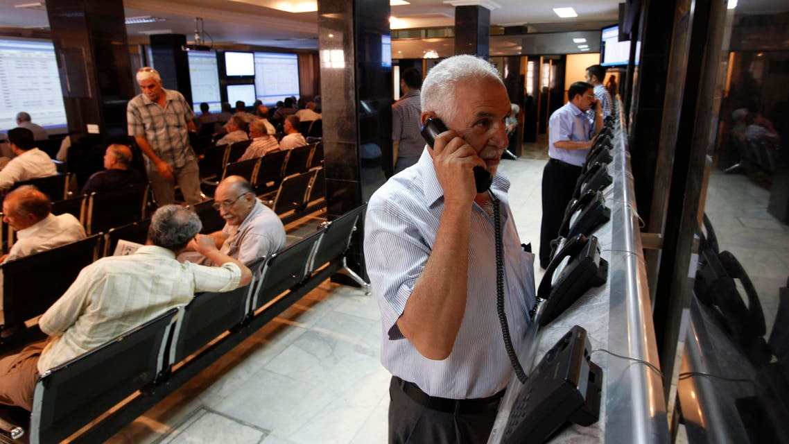 Iraqi stock traders speak on the phone at the Iraq Stock Exchange in Baghdad, Iraq in 2011. (AP)