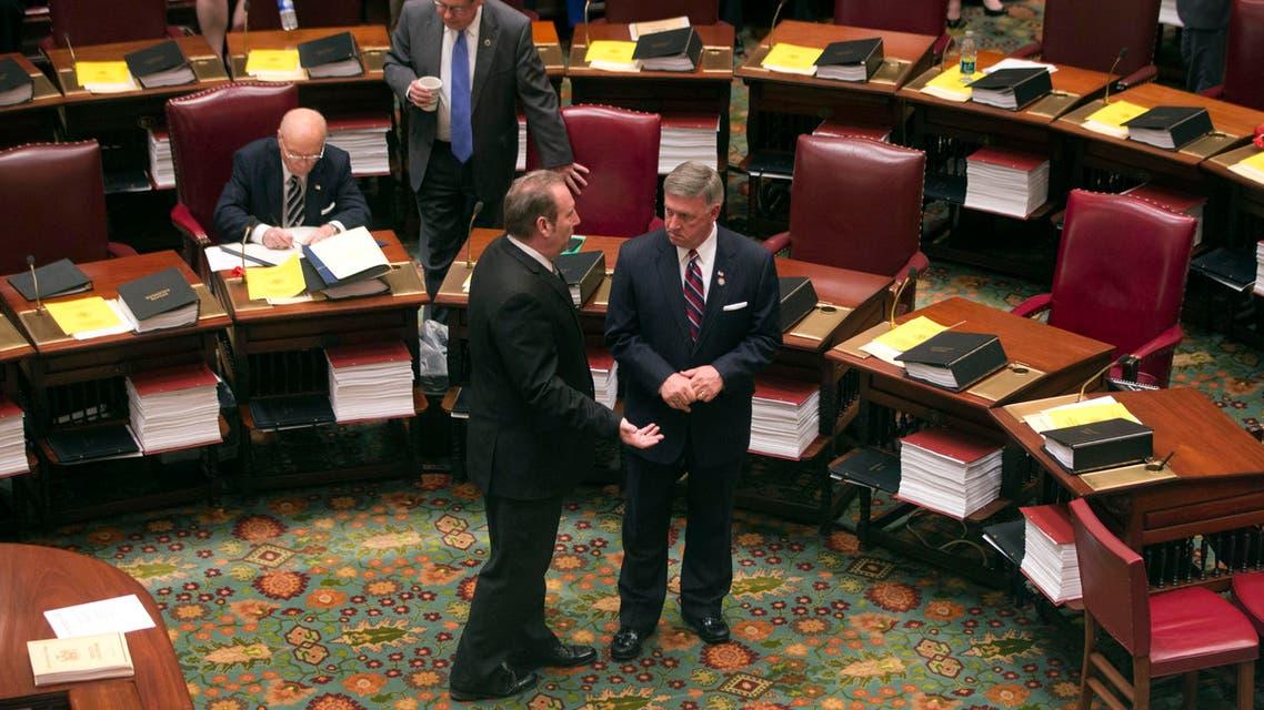 Sen. Joseph Robach, R-Rochester, left, and Sen. Rich Funke, R-Fairport, talk in the Senate Chamber on Wednesday, May 6, 2015. (AP)
