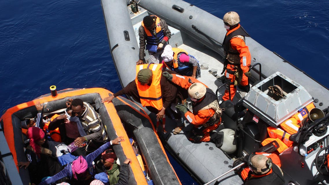 This Handout photo made available by the German Bundeswehr armed forces shows people being rescued by crew of the frigate 'Hessen' in the Mediterranean sea, 130 nautical miles off the Italian island of Lampedusa, on May 8 2015. In their first deployment in the Mediterranean sea, Bundeswehr Marines with two ships rescued around 430 shipwrecked refugees. According to Joint Operations Command, the frigate 'Hessen' took around 250 people on board in international waters, including 30 women and 5 children. AFP PHOTO / HANDOUT / BUNDESWEHR / PAO/ Mittelmeer