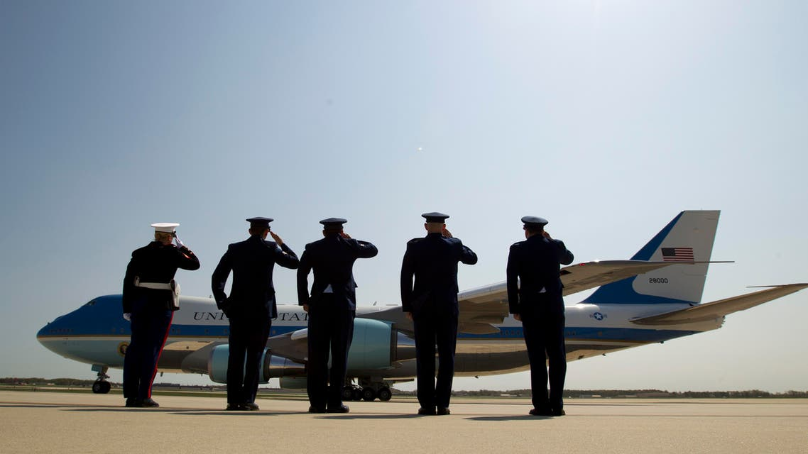 Military personnel salutes as Air Force One, with President Barack Obama aboard, departs from Andrews Air Force Base in Md., Wednesday, April 22, 2015. (AP)