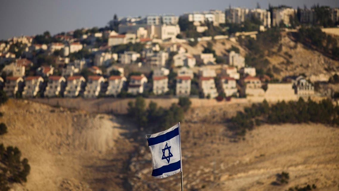 AP an Israeli flag is seen in front of the West Bank Jewish settlement of Maaleh Adumim on the outskirts of Jerusalem