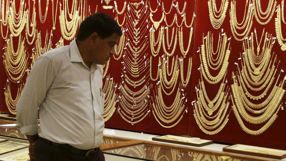 A customer looks at gold ornaments on display in Kochi, India. (Reuters)