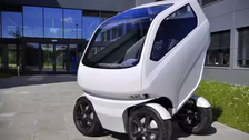 Car that can 'shrink,' drive sideways finally hits the road
