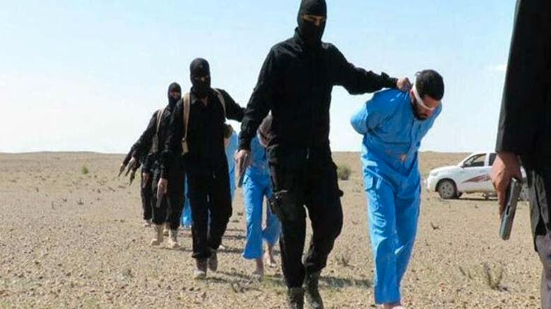 ISIS trades orange for blue jumpsuits in new execution 'video ...