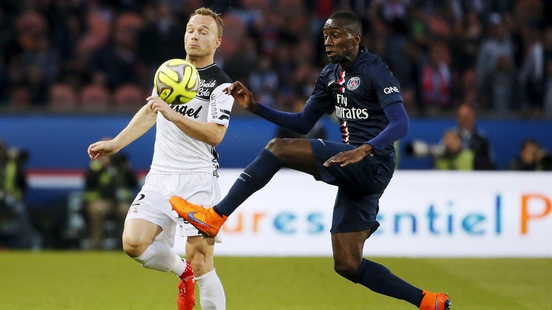 Paris St Germain's Matuidi challenges En Avant Guingamp's Jacobsen during their French Ligue 1 soccer match at Parc des Princes stadium in Paris. Reuters
