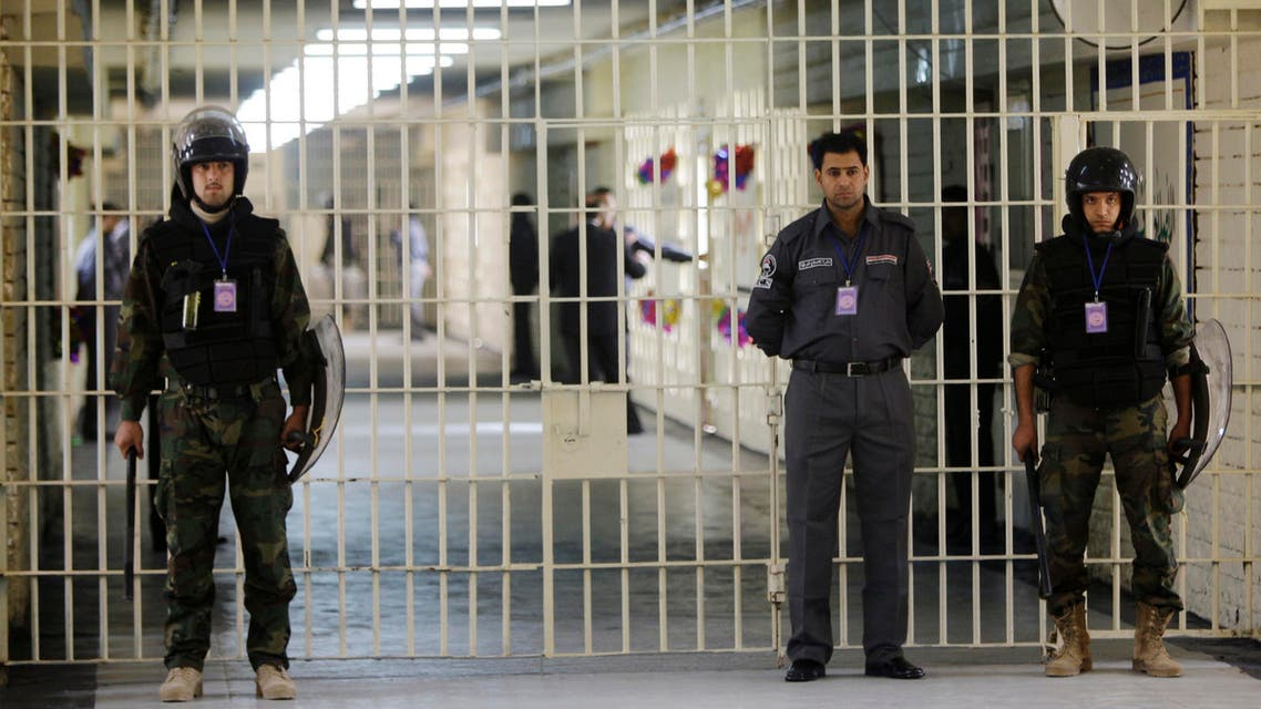 In this Feb. 21, 2009 file photo, guards stand at a cell block at the renovated Abu Ghraib prison, now renamed Baghdad Central Prison. (AP)