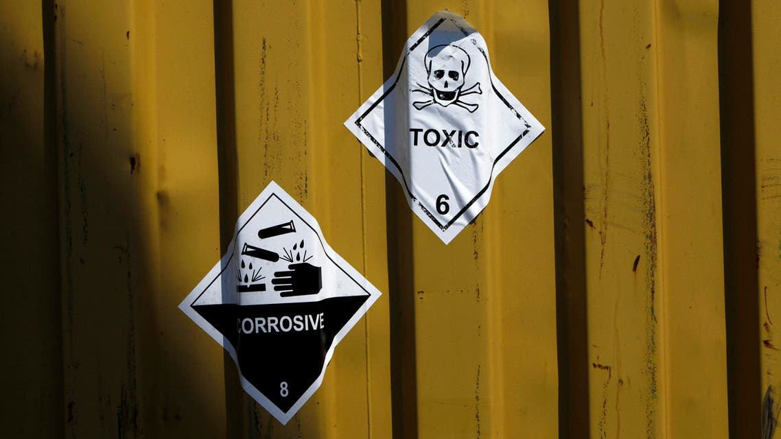 "In this Tuesday May 13, 2014 file photo, signs reading ""Toxic"" are stuck to containers carrying Syria's dangerous chemical weapons aboard the Danish cargo ship. (AP)"