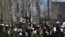 Syrian troops battle to free trapped forces