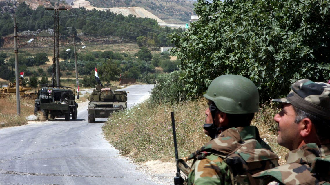 In this photo taken during a government-organized tour for the media, Syrian soldiers and armored vehicles arrive in Istabraq village near the northern town of Jisr al-Shughour, Syria, Saturday, June 11, 2011. AP