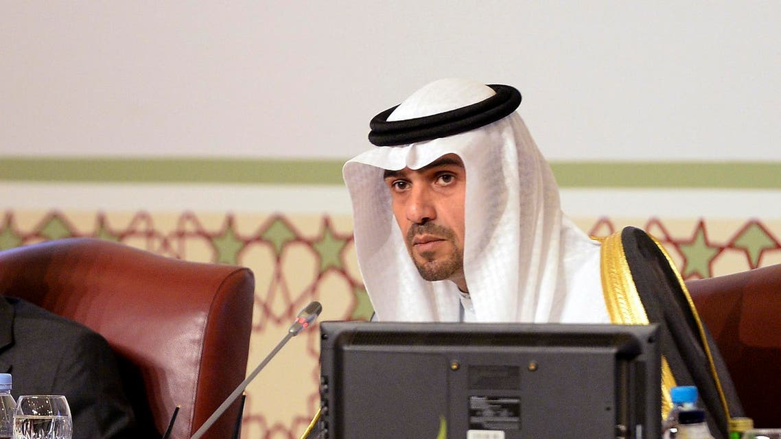 Kuwaiti Minister of Finance Anas Al-Saleh, right, pictured in this archive image dated March 22, 2014. (AP Photo/Nasser Waggi)