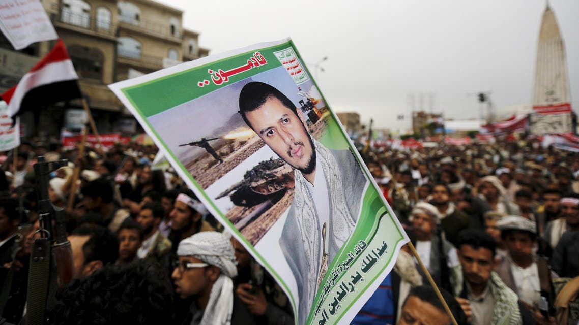 Houthi follower holds up a poster of leader of the Houthi group Abdul Malik Badruddin al-Houthi during a demonstration against the Saudi-led air strikes, in Sanaa. Reuters