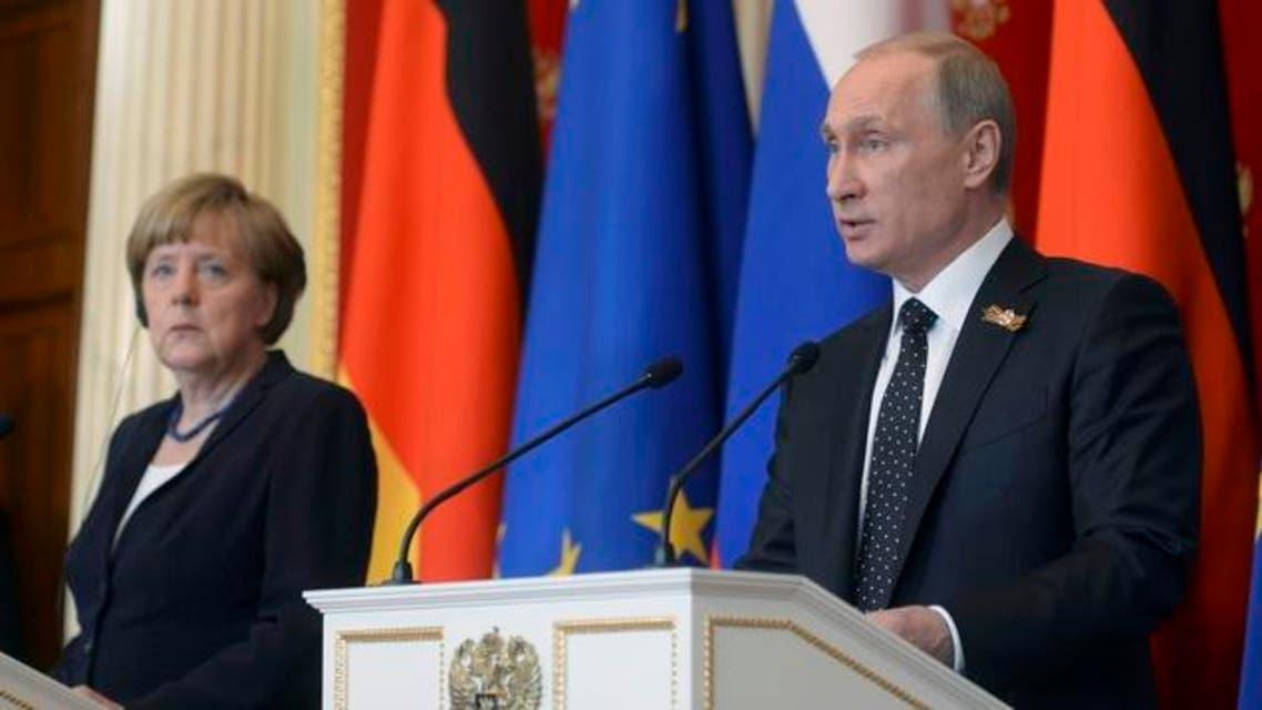 بوتين ميركل موسكو