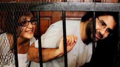تأييد حبس علاء عبدالفتاح وشقيقته في حرق مقر أحمد شفيق