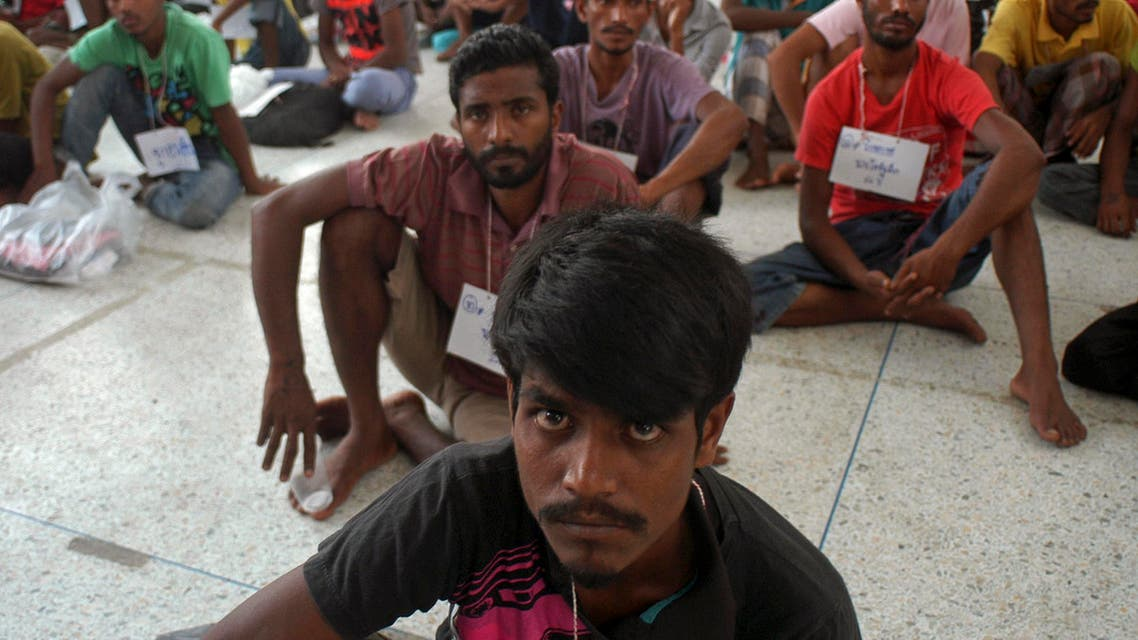 Rohingya migrants sit on the floor at the authority's district office of Rattaphum, Songkla province, southern Thailand, as they were found abandoned in Khao Kaew mountain near the Thai-Malaysia border, Saturday, May 9, 2015. They were provided a temporary shelter at the Rattaphum district. Thailand's police chief announced the arrest of a powerful provincial mayor on Friday and said 50 police officers are being investigated in a widening human trafficking scandal spanning four Asian countries.(AP Photo/Sumeth Panpetch)