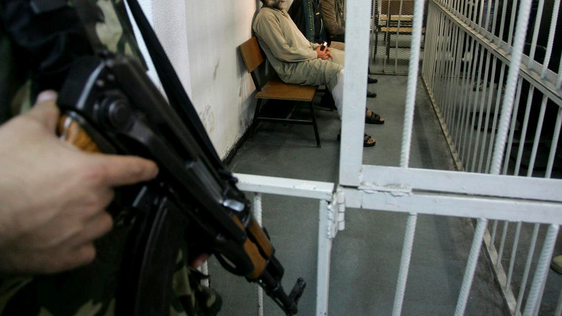 Three Palestinian men accused of murder sit in court for the first military trial of its kind since Hamas took over the Gaza Strip in June, in Gaza City,Tuesday, Nov. 20, 2007. (AP)