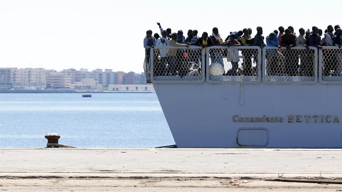 Migrants arrive on the Italian Marines ship Comandante Bettica at the Sicilian harbor of Augusta April 22, 2015. REUTERS