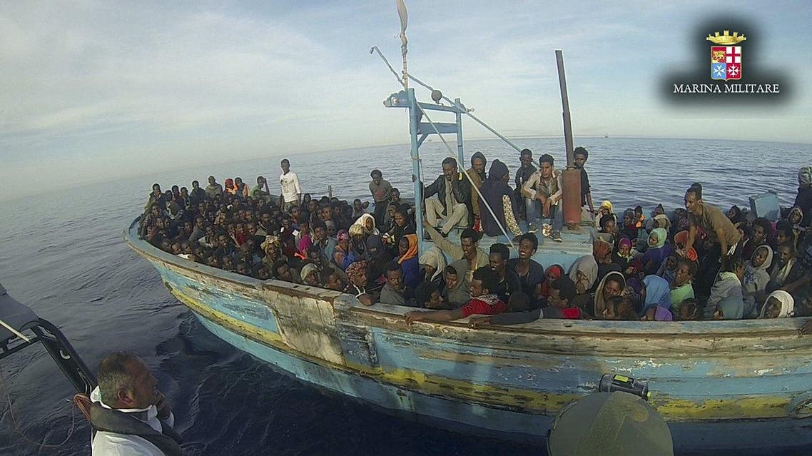 Handout shows migrants sitting in their boat during a rescue operation by Italian navy ship Vega off the coast of Sicily reuters
