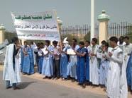 نائب موريتاني يحتج على العطش بدلو في افتتاح البرلمان
