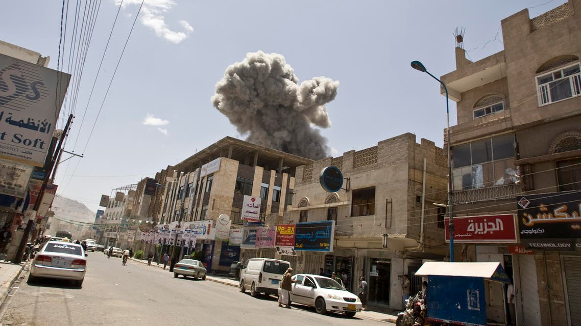 Smoke rises from a house of former Yemeni President Ali Abdullah Saleh after a Saudi-led airstrike in Sanaa, Yemen, Sunday, May 10, 2015. (AP Photo/Hani Mohammed)