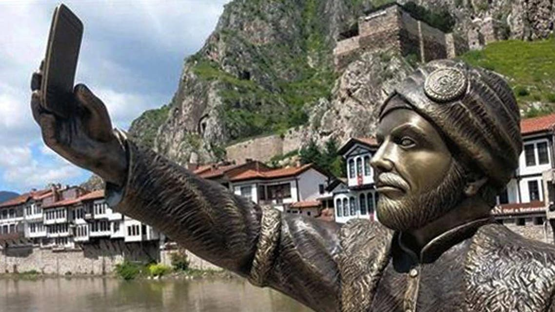 This May 10, 2015 photo shows a statue of an Ottoman prince taking a selfie with a cellphone erected in Amasya, Turkey. (AP)