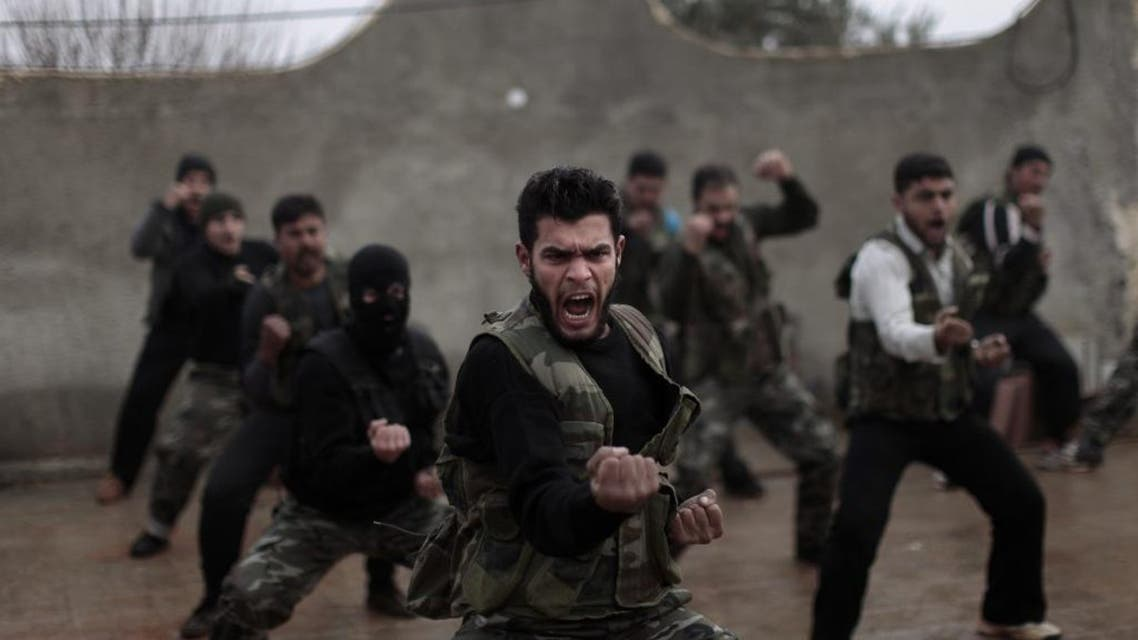 Syrian rebels attend a training session in Maaret Ikhwan, near Idlib, Syria, in December 2012. AP