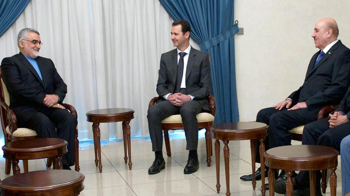A handout picture released by the official Syrian Arab News Agency on May 13, 2015 shows President Bashar al-Assad (C) meeting with Chairman of the Iranian Shura Council's Committee for Foreign Policy and Syria's security services chief Ali Mamluk in Damascus. (AFP)