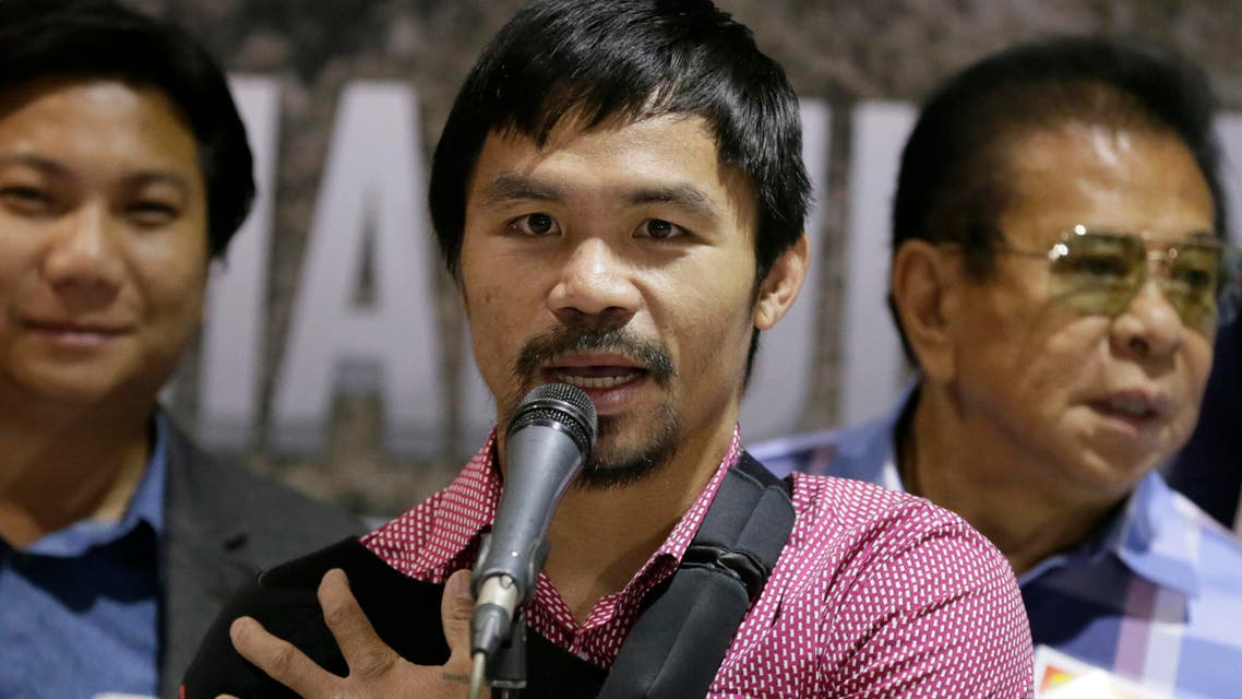 Filipino boxer and Congressman Manny Pacquiao answers questions from the media during a news conference upon arrival Wednesday, May 13, 2015  AP