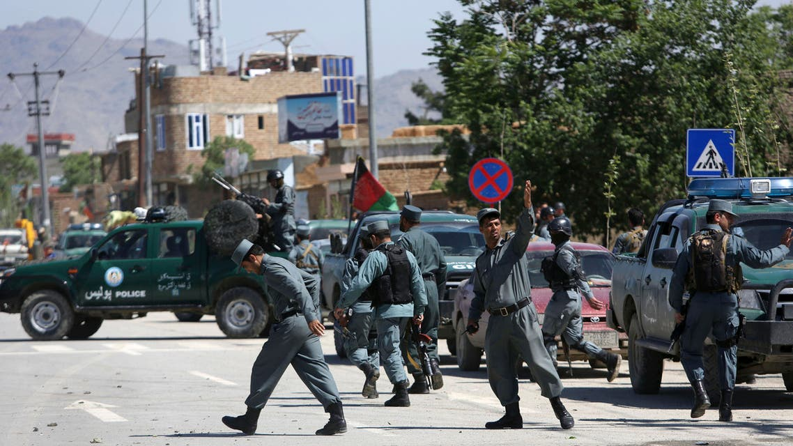 Afghan security forces inspect the site of an explosion in Kabul, Afghanistan, Wednesday, May 13, 2015. Afghan officials confirmed that it was a bomb attached to a car with magnets that destroyed the vehicle and injured several police. (AP Photo/Rahmat Gul)