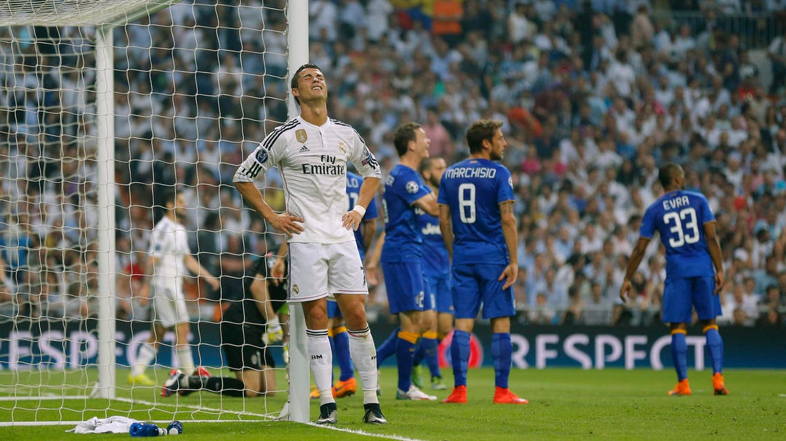 Real Madrid's Cristiano Ronaldo leans against the post after failing to score during the Champions League second leg semifinal soccer match between Real Madrid and Juventus, at the Santiago Bernabeu stadium in Madrid, Wednesday, May 13, 2015. (AP Photo/Daniel Ochoa de Olza)