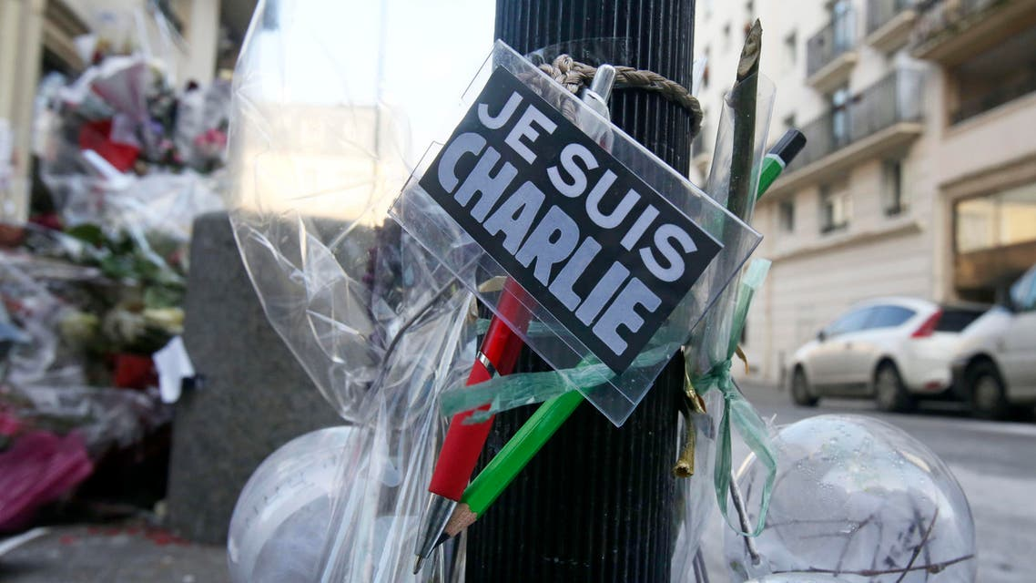 Flowers are laid near the headquarters of magazine Charlie Hebdo in Paris, Friday Feb. 6, 2015. AP
