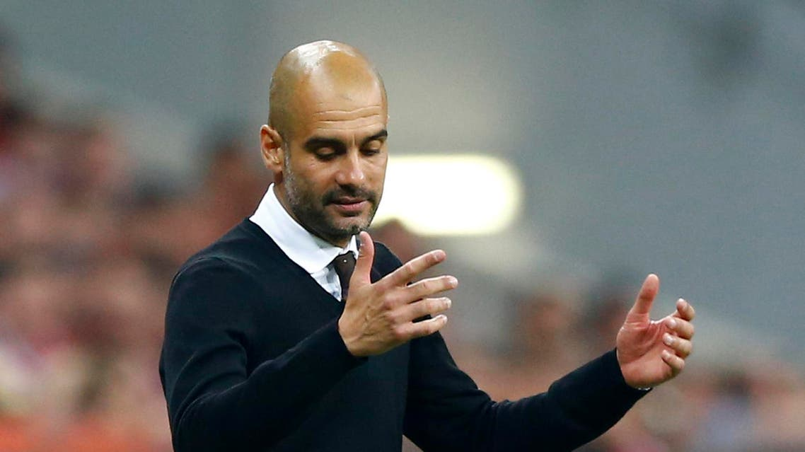 Bayern's head coach Pep Guardiola reacts as his team fails to advance to the final during the soccer Champions League second leg semifinal match between Bayern Munich and FC Barcelona at Allianz Arena in Munich, southern Germany, Tuesday, May 12, 2015. (AP Photo/Matthias Schrader)