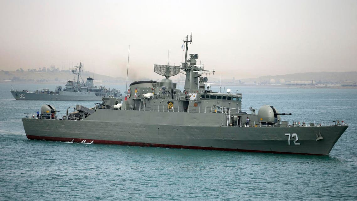 In this picture taken on Tuesday, April 7, 2015, and released by the semi-official Fars News Agency, Iranian warship Alborz, foreground, prepares before leaving Iran's waters. AP