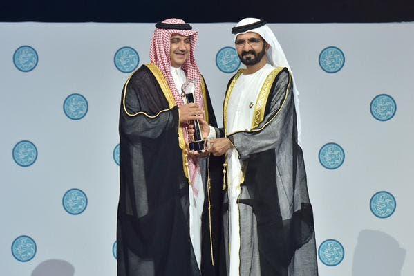 Dubai ruler Sheikh Mohammed bin Rashid Al Maktoum awards Sheikh Waleed al-Ibrahim for his achievements over last 25 years DUBIA MEDIA OFFICE