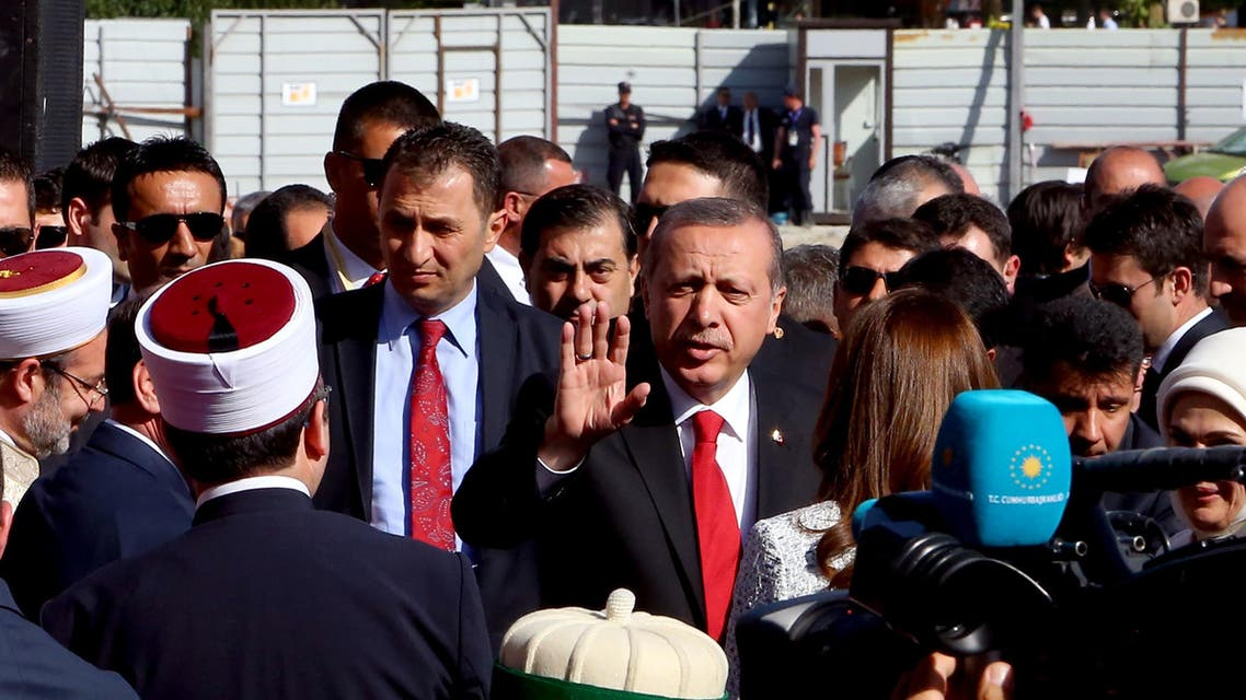 Turkey's President Recep Tayyip Erdogan hails Albanian Muslims at the inauguration ceremony of the Namazgja Mosque construction that started to be built in Tirana Wednesday, May 13, 2015 with a 30 million euro funding from Turkey. Erdogan held a visit to Tirana to discuss increasing economic ties with the small Balkan nation, heading a delegation of about 100 businessmen as he arrived in the capital for meetings with Albanian government officials. (AP Photo/Hektor Pustina)