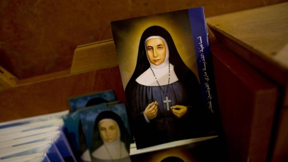In this Thursday, May 7, 2015 photo, booklets showing the likes of Marie Alphonsine Ghattas, a nun who lived in what was Ottoman-ruled Palestine in the 19th century, are on display in Church of the Rosary Sisters Mamilla in Jerusalem. (AP)