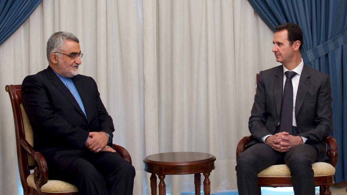 الأسد مع مسؤول إيراني