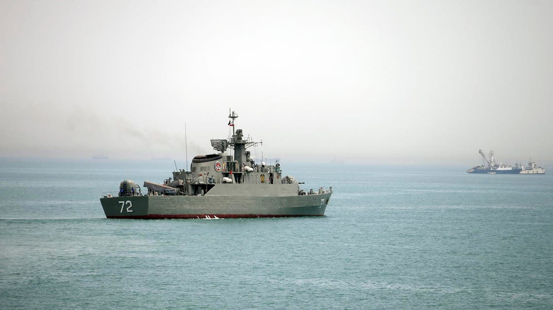In this picture taken on Tuesday, April 7, 2015, and released by the semi-official Fars News Agency, Iranian warship Alborz, foreground, prepares before leaving Iran's waters, at the Strait of Hormuz. AP