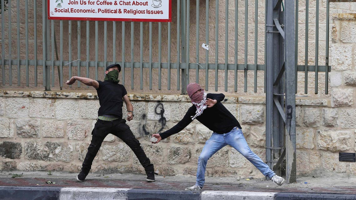 Palestinian protesters throw stones towards Israeli troops during clashes following a rally ahead of the Nakba day in the West Bank city of Bethlehem May 14, 2015. REUTERS