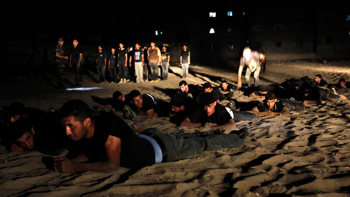 Palestinian youths crawl during a night military-style exercises run by militants from the al-Nasser Brigades, an armed wing of the Popular Resistance Committees (PRC), at their training camp in Gaza City. (File: AP)